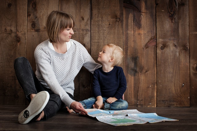 Mother talking to her son and holding a map