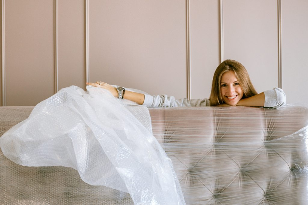 A woman packing a couch.